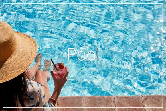 Woman drink at poolside Villa di Piazzano SLH Luxury Hotel Cortona tuscany