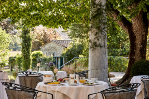 Breakfast time in the garden at Villa di Piazzano SLH Luxury Hotel Cortona tuscany