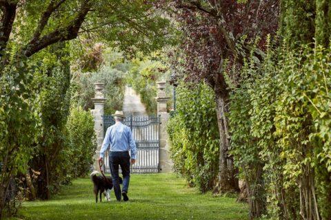 Man with dog garden Villa di Piazzano SLH Luxury Hotel Cortona tuscany