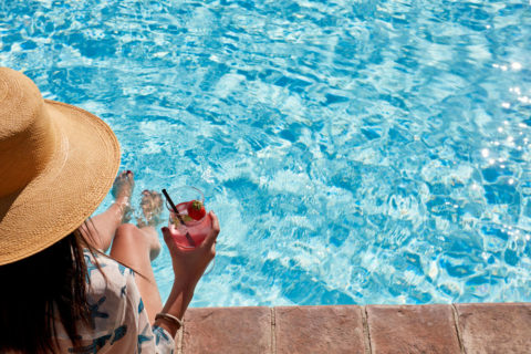Woman drink at poolside Villa di Piazzano SLH Luxury Hotel Cortona tuscany