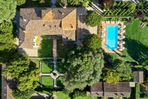 Arial view Villa di Piazzano SLH Luxury Hotel Cortona tuscany pool