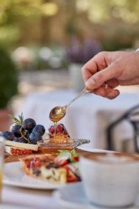 Breakfast time in the garden at Villa di Piazzano SLH Luxury Hotel Cortona tuscany